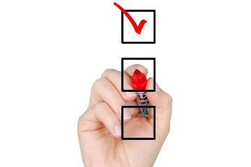 Wat zegt het Vlaams woninghuurdecreet over de intredende en uittredende plaatsbeschrijving?